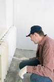 Man painting radiator poster