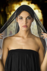 beautiful woman with a black veil on her head like black wife