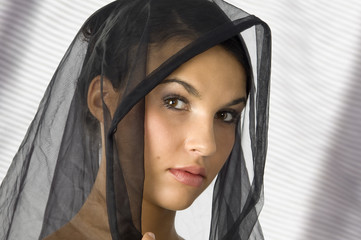 nice portrait of a young woman with a black veil on her head