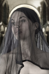 attractive widow with a black transparent veil on face