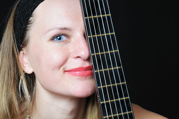 portrait of the nice woman behind fretboard