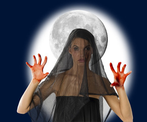 woman with black veil and bloody hand with a big moon in