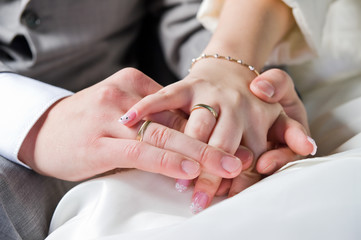 hands and rings of just married couple