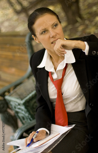 outdoor portrait of businesswoman with documents