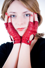 Portrait of a young girl in red gloves