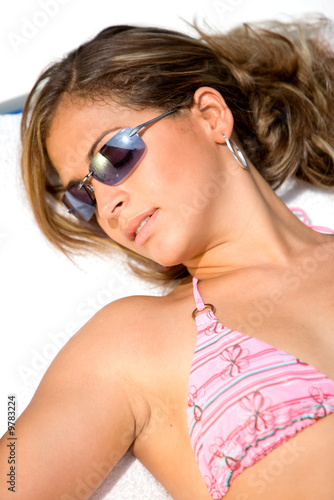 beautiful woman relaxing on vacation wearing sunglasses