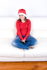 beautiful young woman smiling with red christmas hat