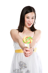 A beautiful asian woman holding a colorful lollipop