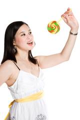 A beautiful asian woman eating a lollipop