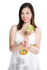 A beautiful asian woman holding two lollipops