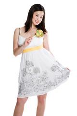 A beautiful asian woman holding a lollipop