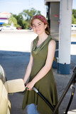 Young woman filling up her  fuel efficient car. poster