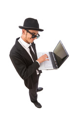 funny looking computer hacker with laptop on white