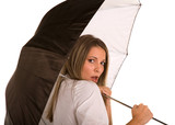 Attractive Young Woman under Umbrella with Concerned Look poster