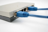 network router with two blue cables poster
