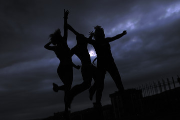 three teens jumping in air representing disco and party