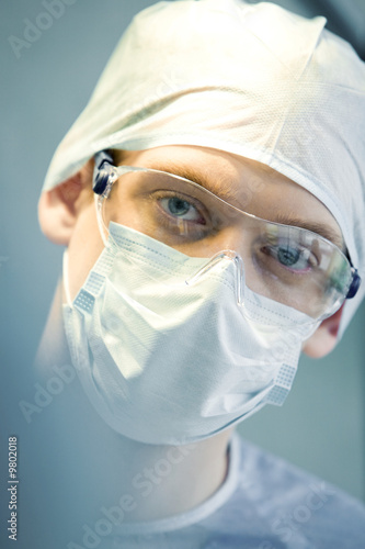 Portrait of young  specialist with mask