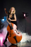 Young woman in studio with contrabass poster