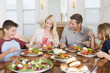 Family Enjoying meal,mealtime Together - 9802634