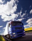 Fototapety truck driving at dusk/motion blur