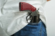 Close up of a pistol holded in jeans back pocket