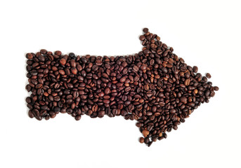 Coffee beans arranged in arrow shape - close up