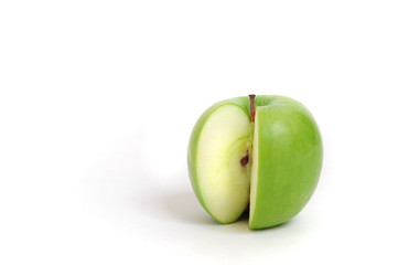 Close up of a green sliced apple on white background