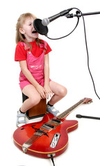 little girl sing to studio microphone