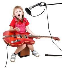 little girl sing to studio microphone