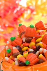 Orange pumpkin filled with delicious Halloween candies.