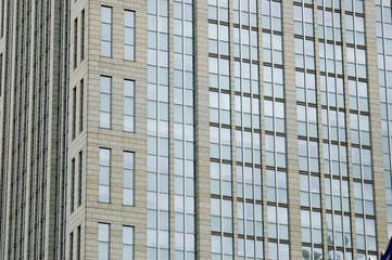China, Shanghai. Glass panels of modern building.