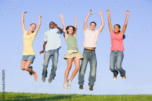 Portrait Of A Group Of Teenagers Jumping