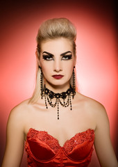 Sexy vamp woman with creative hairstyle and make-up