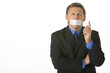 Businessman With His Mouth Taped Shut And Pointing