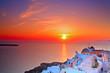 Leinwandbild Motiv Sunset in Oia village on Santorini island, Greece