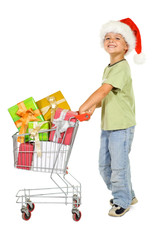 Happy boy shopping for christmas with a cart - isolated
