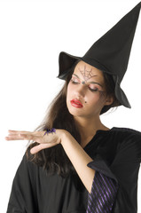 pretty girl with witch hat and a spider on her hand