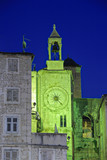 Famous Romanesque tower clock in Split, Croatia at night poster