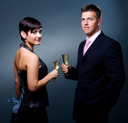Couple drinking champagne on a party.