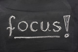 word focus with an exclamation mark handwritten on blackboard poster