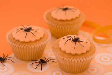 Halloween spider cupcakes in orange setting