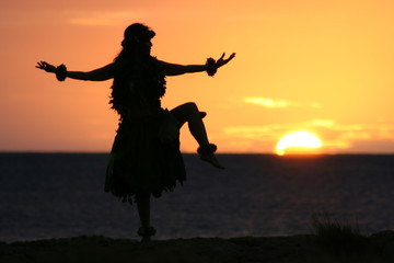 Hula dancer in  the sunset