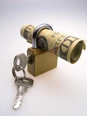 braided dollars inserted into  closed padlock