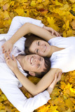 Fototapety happy couple laying on yellow leaves
