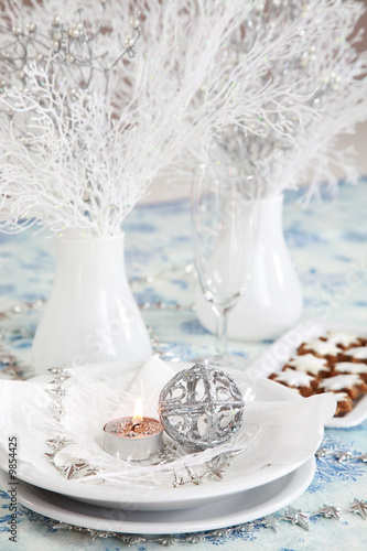 Christmas table setting in white and silver tone