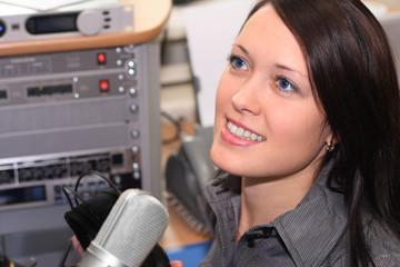 Radio DJ is in a studio
