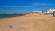 Busy working beach at the resort of Armação de Pêra, Portugal