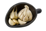 Garlic bulb and cloves on a primitive, wooden, scoop, isolated poster