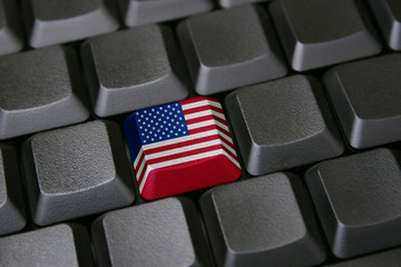 Computer keyboard with one key colored with American flag.