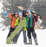 Happy snowboarding team in winter mountains, health lifestyle